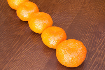 fresh bunch of mandarines in a wooden background