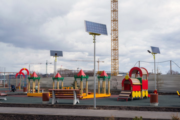 children's playground  of an apartment house with solar panels