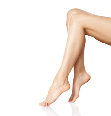 Beautiful smooth and shaved female legs . Isolated on white.