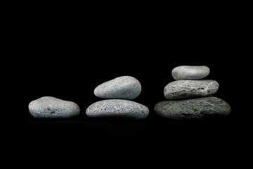 Concept of growth. Stones on black background