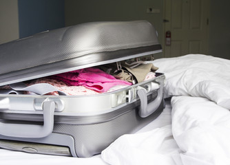 Luggage on the bed