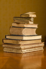 old books on a wooden table