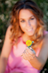 Woman holding a yellow flower