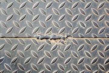 The damage metal diamond plate