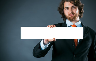 Businessman holding a rectangular blank sign