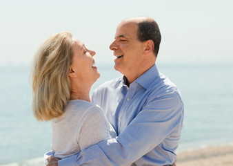 Happy aged lovers laughting outdoor