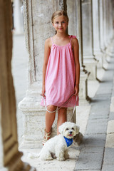 Portrait of fashion girl with Maltese dog in Venice, Italy