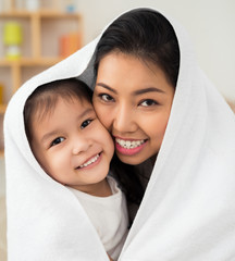 Cheerful Asian mother and daughter