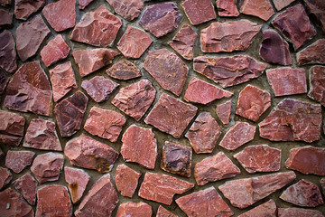 background stone wall pink color close up