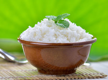 "Постер, картина, фотообои ""Cooked white rice garnished with mint in a ceramic bowl"""