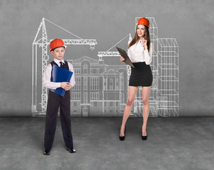 Little boy and woman builder