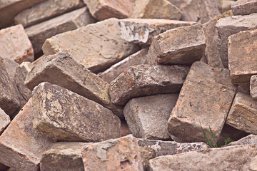 Pile of Old Used Bricks as Construction Material