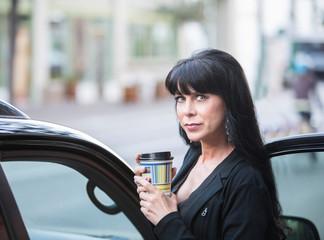 Beautiful Woman Downtown with Coffee