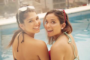 Happy young women having fun in swimming pool