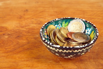 Coins in ceramic cup