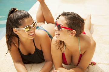 Happy teenage friends having fun in swimming pool