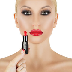 glamorous model on white background applying red lipstick