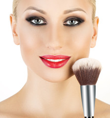 Beauty Girl with Makeup Brushes.