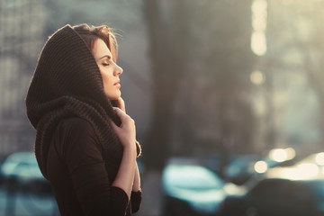 The mysterious pensive woman in a hood