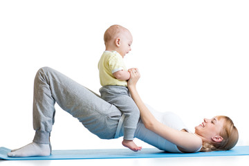 young mother does fitness exercises together with baby