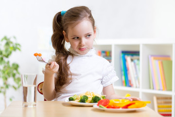 kid refusing to eat his dinner