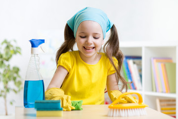 cute girl make cleaning in the children room at home