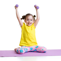 Active kid exercising isolated on white background