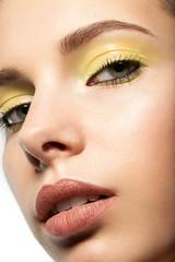 Spring makeup closeup with yellow eye shadow