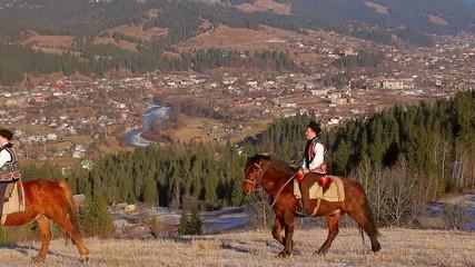 Gutsul go round the city on horses.