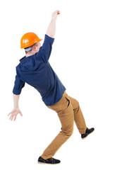 Balancing young man.  or dodge falling man/ worker in constructi