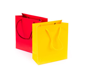 Two shopping bags, red and yellow
