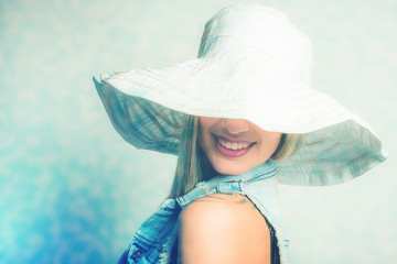 young woman jeans fashion with white summer hat