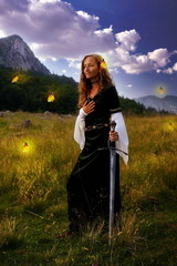 mystical woman with a sword  on a  mountain with butterflies