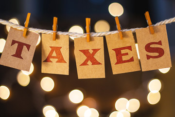 Taxes Concept Clipped Cards and Lights