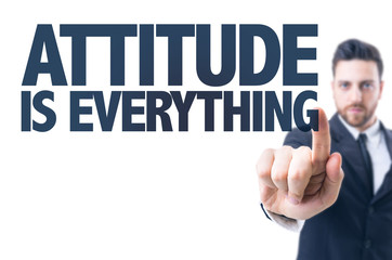 Business man pointing the text: Attitude is Everything