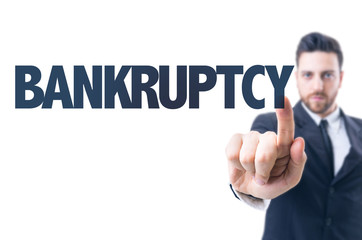 Business man pointing the text: Bankruptcy