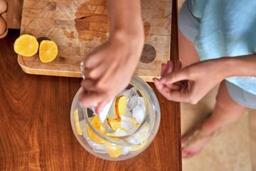 woman making ice water lemonade