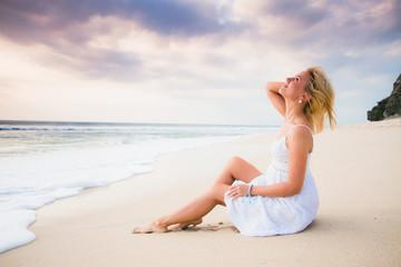 Happy woman at the coast