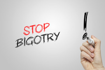 Hand writing stop bigotry