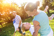 Happy young family spending time together outside in nature - 81875906