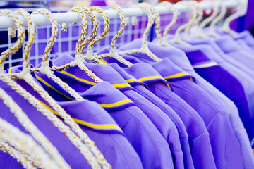 The set of purple T-shirts for sale.
