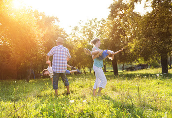 Happy young family spending time together outside in nature