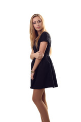 A stylish young blonde woman in black dress in little black dres