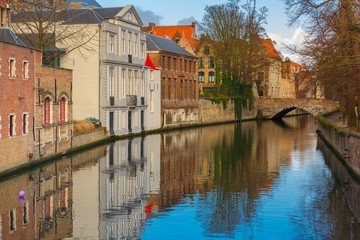 Green canal and bridge in Bruges, Belgium