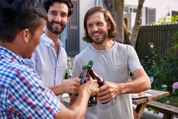 men toasting with beers