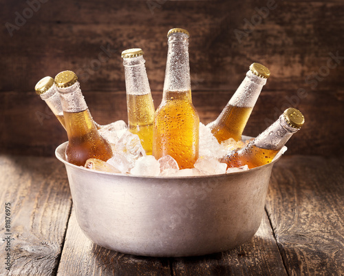 cold bottles of beer in bucket with ice - 81876975