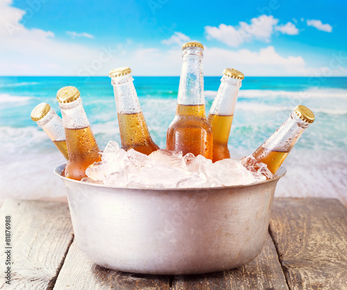 cold bottles of beer in bucket with ice - 81876988
