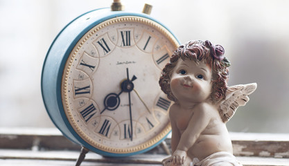 Vintage clock and little angel