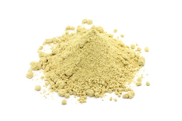 a handful of mustard powder on a white background
