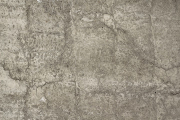 Reinforced concrete wall with cracks abstract background